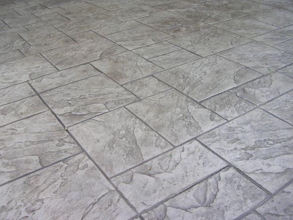 Grey brick stamped concrete