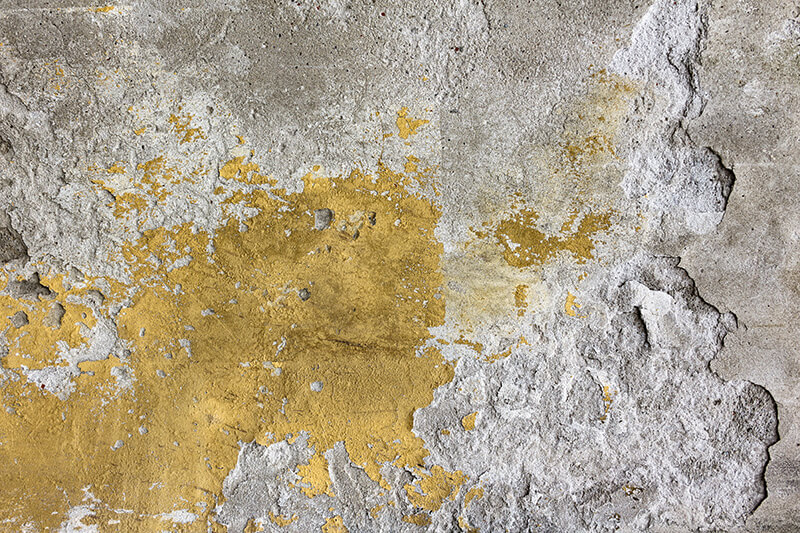 Slab of damaged, discoloured concrete