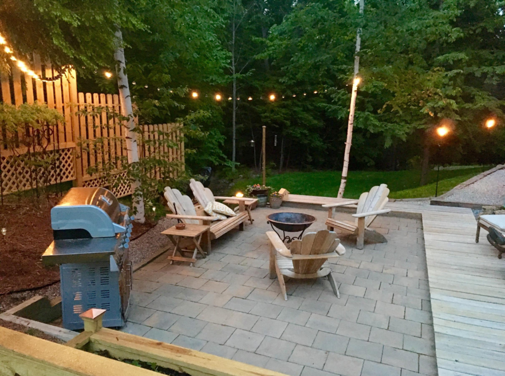 view of newly renovated patio with concrete interlocking and wood furniture