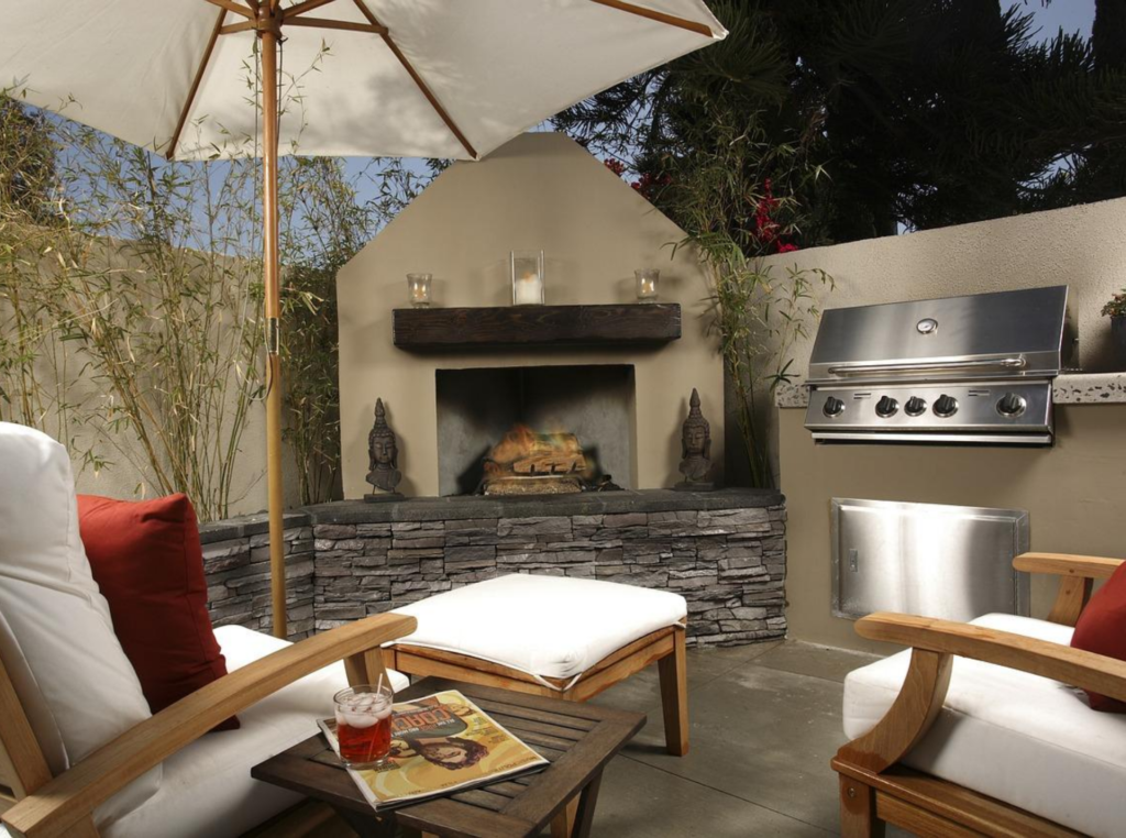 outdoor kitchen patio design using concrete with a fireplace